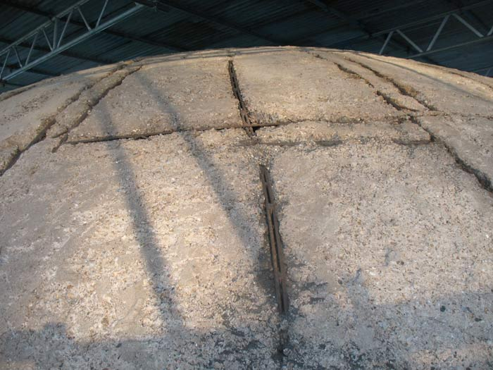 Damage to the concrete around the bar lines atop the Dome